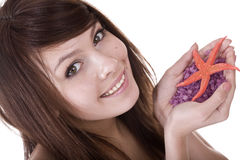 Attractive woman and starfish. Spa. Royalty Free Stock Image