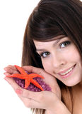 Attractive   woman   and  starfish. Spa . Royalty Free Stock Image