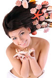 Attractive   woman   and  starfish. Spa. Stock Photo