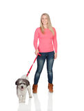 Attractive woman sticking out walking his dog Royalty Free Stock Images