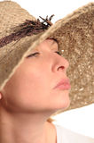 Attractive woman and straw hat Stock Photos