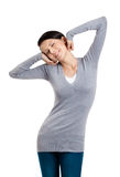 Attractive woman stretches herself Royalty Free Stock Photo