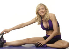 Attractive woman stretching Royalty Free Stock Images