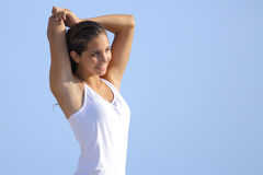Attractive woman stretching arms outdoor Royalty Free Stock Photos