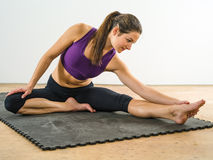 Attractive woman stretching her legs Royalty Free Stock Image