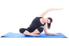 Attractive woman stretching the muscles isolated on white backgr Stock Photos