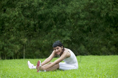 Attractive woman stretching outdoor Stock Photography