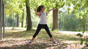 Attractive Woman stretching outdoor stock video footage