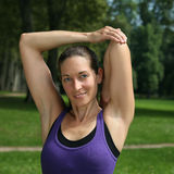 Attractive woman stretching before running or jogging Royalty Free Stock Photography