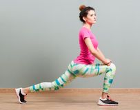 Attractive woman stretching and shaping her thighs Stock Photo