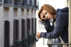 Attractive woman suffering depression and stress alone in pain smoking at balcony Royalty Free Stock Photography