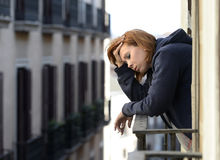 Attractive woman suffering depression and stress outdoors at the balcony Royalty Free Stock Image