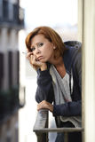 Attractive woman suffering depression and stress outdoors at the balcony Stock Photos