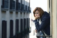 Attractive woman suffering depression and stress outdoors at the balcony Royalty Free Stock Images