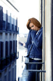 Attractive woman suffering depression and stress outdoors at the balcony Stock Photography