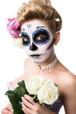 Attractive woman with sugar skull make-up Stock Photos