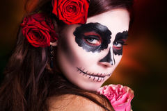 Attractive woman with sugar skull make-up royalty free stock photography