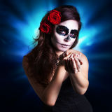 Attractive woman with sugar skull make-up. And roses royalty free stock images