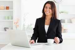 Attractive woman in suit enjoying Royalty Free Stock Image