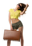 Attractive woman with suitcase Stock Photography