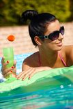 Attractive woman at summer in pool Stock Images