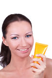 Attractive woman with sun cream in her hand Stock Image