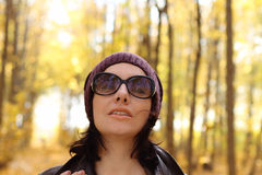 Attractive woman in sun glasses in park in a sunny Stock Image
