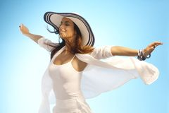 Attractive woman in sun and wind stock image