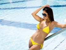 Attractive Woman Sunbathing. Woman sunbathing by the swimming pool Stock Images