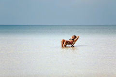 Attractive woman sunbathing in gorgeous crystal water, cambodia Stock Photography
