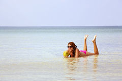 Attractive woman sunbathing in gorgeous crystal water, cambodia Stock Photo