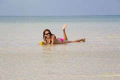 Attractive woman sunbathing in gorgeous crystal water, cambodia Royalty Free Stock Images