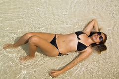 Attractive woman sunbathing in gorgeous crystal water, cambodia Royalty Free Stock Image