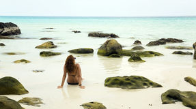 Attractive woman sunbathing in gorgeous crystal water, cambodia Stock Images