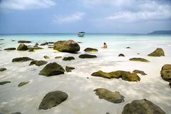 Attractive woman sunbathing in gorgeous crystal water, cambodia Royalty Free Stock Photography