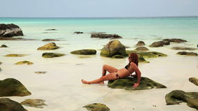 Attractive woman sunbathing in gorgeous crystal water, cambodia stock video