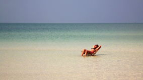 Attractive woman sunbathing in gorgeous crystal water,cambodia stock video