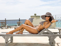 Attractive Woman Sunbathing on Lounge Chair Royalty Free Stock Photo