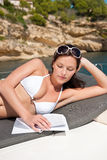 Attractive woman sunbathing on luxury boat Royalty Free Stock Image