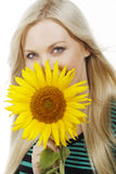Attractive woman with sunflower. Isolated on white Stock Photography