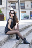 Attractive woman with sunglasses sitting on stairs, urban lifest Stock Photos