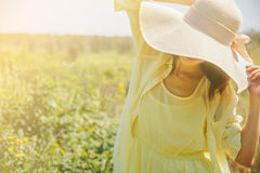 Attractive woman in sunny day Stock Photos