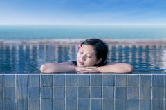 Attractive woman at swimming pool Royalty Free Stock Photography