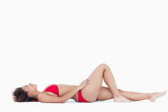 Attractive woman in swimsuit lying down Stock Image