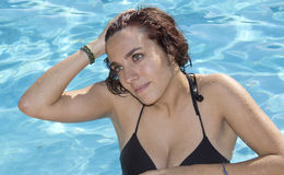 Attractive woman in swimsuit at the pool Royalty Free Stock Images