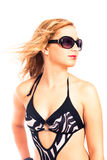 Attractive woman in swimsuit and sunglasses Stock Image