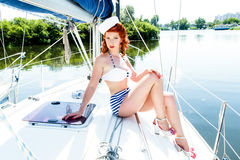 Attractive woman in swimsuit on yacht Royalty Free Stock Image