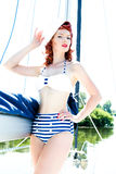 Attractive woman in swimsuit on yacht Stock Image