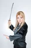 Attractive woman with sword Stock Photos