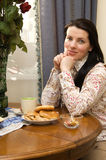 Attractive woman at the table Royalty Free Stock Photo